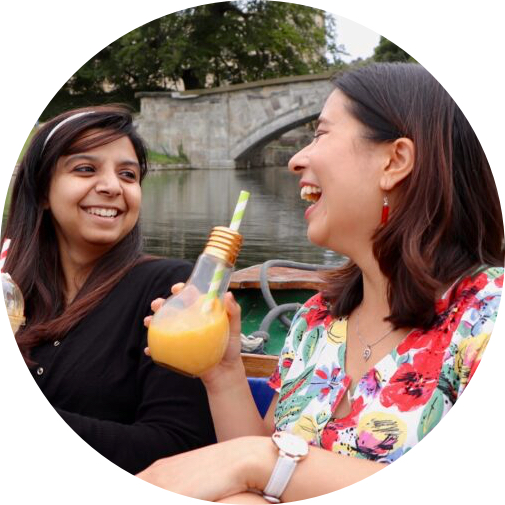 close up of 2 women drinking and laughing together on a punt