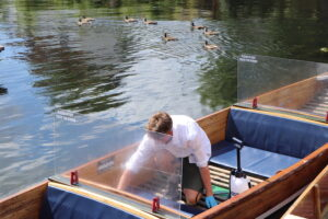 screen cleaning on a chauffeured punt in Cambridge